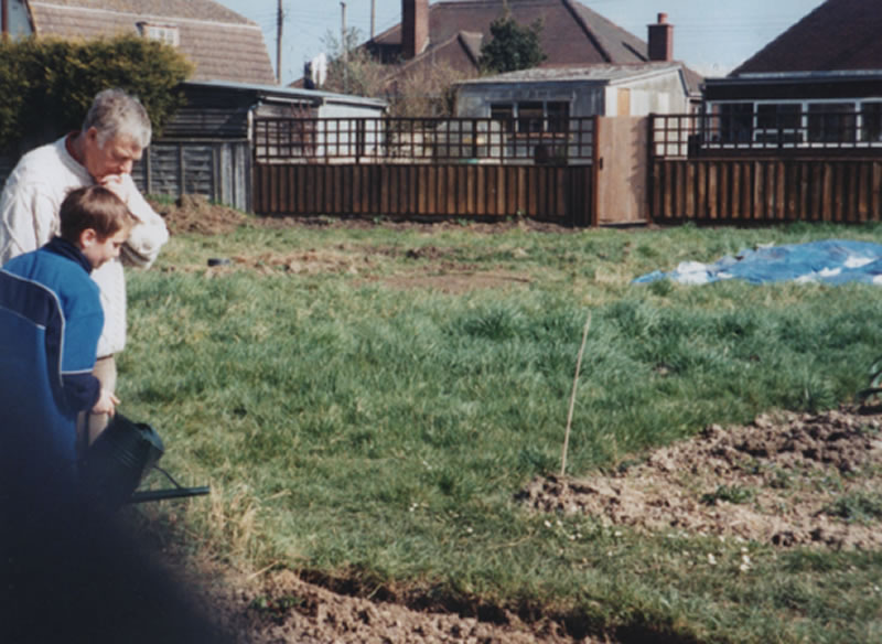 Brian Tullett and son pondering the work 1980s
